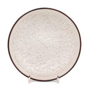 A Chinese Dingyao Style White Glazed Molded Porcelain