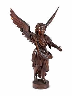 A Carved Walnut Figure of Angel Gabriel