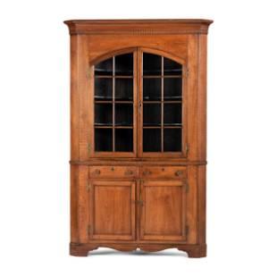 A Chippendale Incised Walnut Corner Cupboard