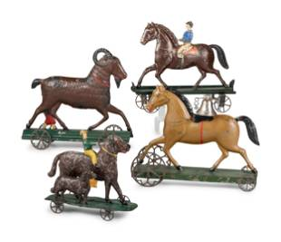 Four Pressed and Painted Tin Figural Pull Toys