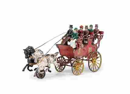 A Hubley Cast Iron Three-Seat Two-Horse Drawn Brake