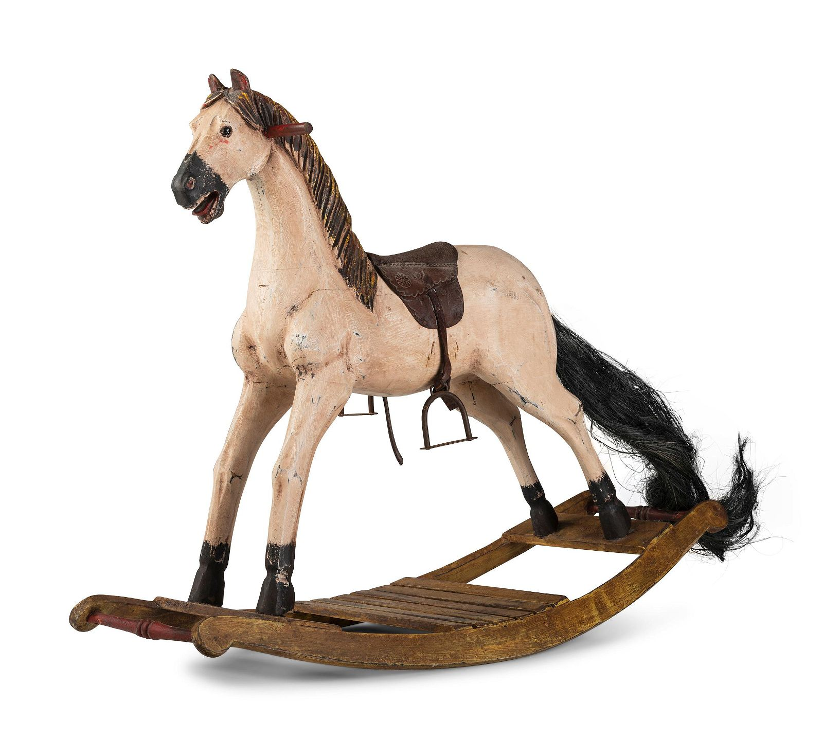 A Carved and Painted Wooden Rocking Horse