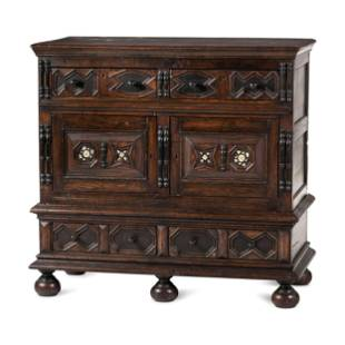 A Flemish Paneled and Molded Oak Chest of Drawers