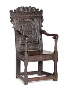 An English Carved Oak and Elm Panel-Back Armchair