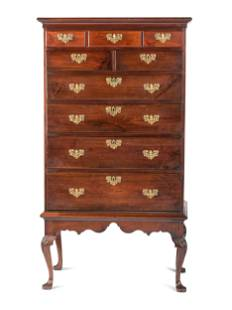A Chippendale Walnut Shell Carved Flat-Top Chest on