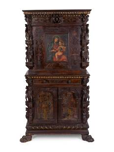 A Spanish Colonial Style Carved Oak and Painted