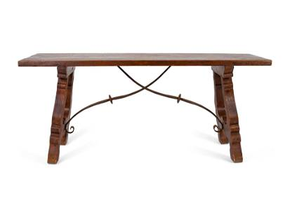 A Spanish Colonial Style Trestle Table With Wrought