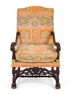 A Spanish Colonial Style Carved Walnut Open Armchair