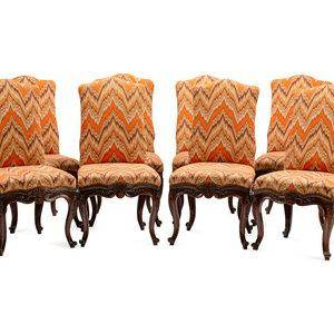 A Set of Eight Continental Carved Walnut Dining Chairs