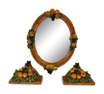 A Set of Italian Painted Terracotta Mirror and Wall