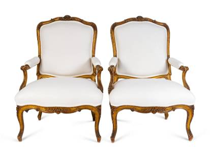 A Pair of Louis XV Giltwood Bergeres Height 42 x width