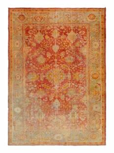 An Oushak Wool Rug 12 feet 6 inches x 9 feet 3 inches.