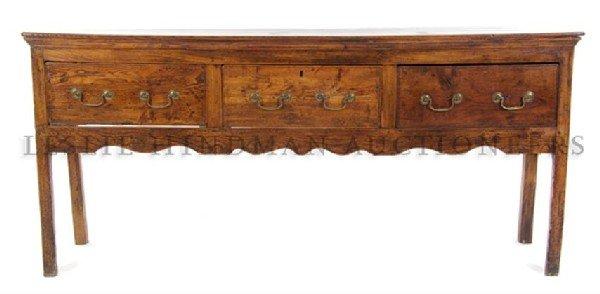 An English Oak Sideboard, Height 33 3/4 x width 73 3/4