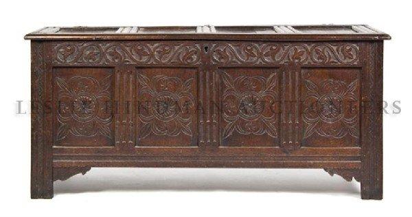A Jacobean Carved Oak Chest, Height 27 x width 60 1/2 x