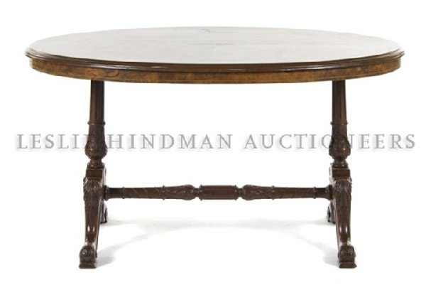 A Walnut Occasional Table, Height 22 1/4 x width 40 1/2