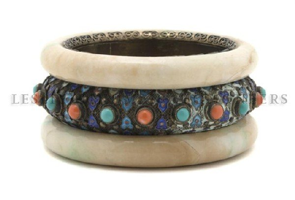 611: Two Jade Bangles in a Sterling Mount, Diameter 3 i