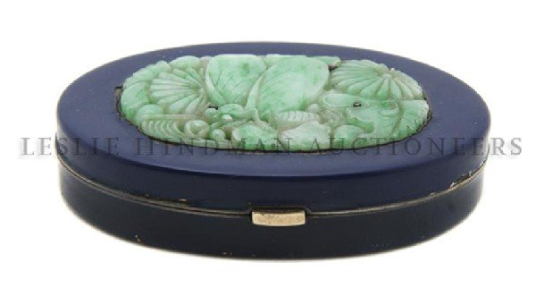 613: An Enamel and Jade Compact, Width 2 3/4 inches.