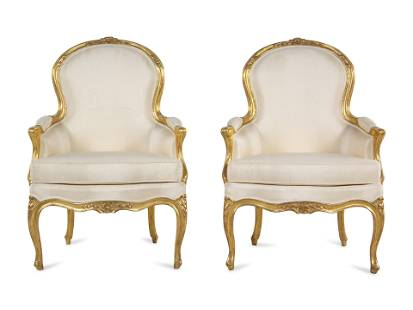 A Pair of Louis XV Carved Giltwood Bergeres
