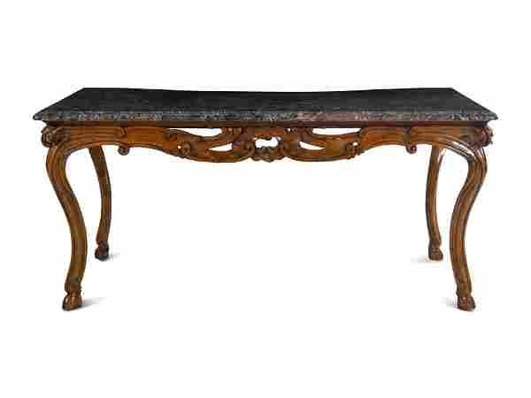 A French Provincial Carved Walnut Marble-Top Center