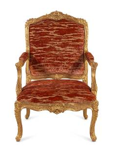 A Louis XV Style Carved Giltwood Fauteuil
