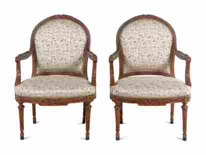 A Pair of Louis XVI Carved Walnut Fauteuils
