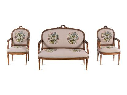 A Louis XVI Carved Walnut Seating Suite with Petit