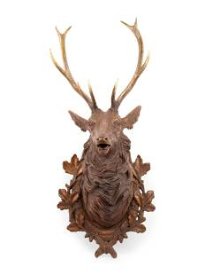 A Black Forest Carved Stag Head