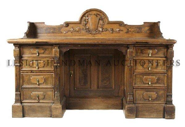 A Victorian Carved Oak Pedestal Desk, Height 43 1/4 x w