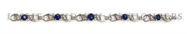 A Platinum, Diamond, and Star Sapphire Bracelet, 15.20