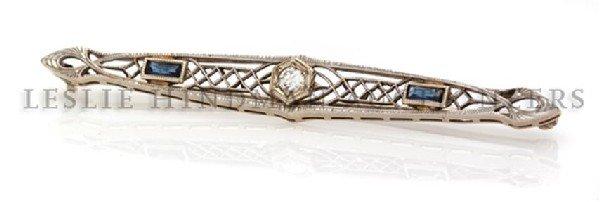 A 14 Karat White Gold, Diamond and Sapphire Bar Pin, 2.