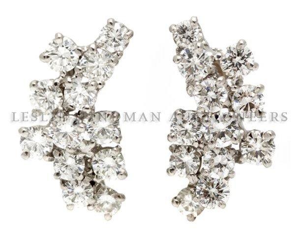 A Pair of 14 Karat White Gold and Diamond Spray Earring