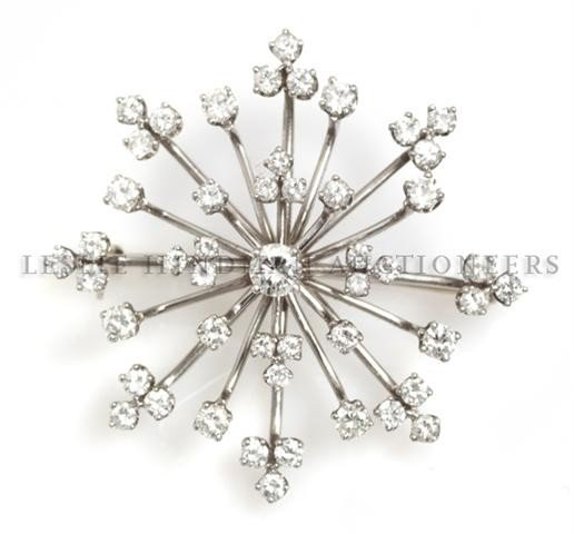 A Platinum and Diamond Snowflake Brooch, 9.25 dwts.