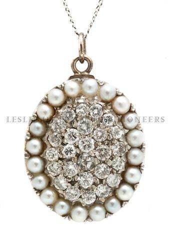 A 14 Karat White Gold, Diamond and Cultured Pearl Penda