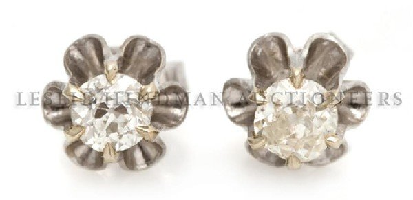 A Pair of 14 Karat White Gold and Diamond Stud Earrings