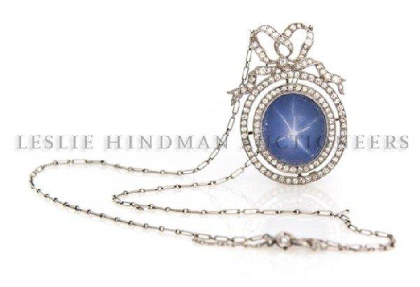 An Edwardian Platinum, Star Sapphire and Diamond Neckla