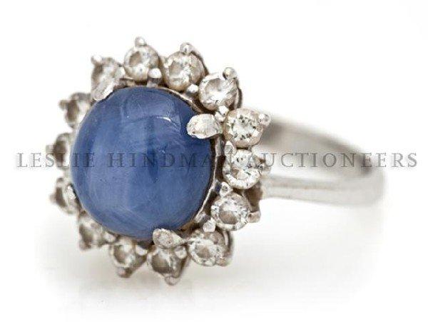 A 14 Karat White Gold, Blue Star Sapphire and Diamond R