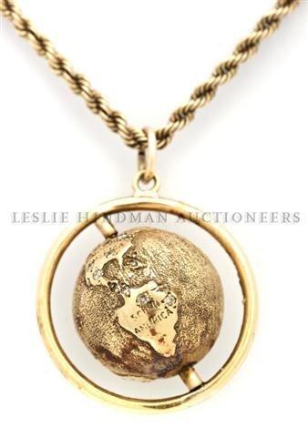 A 14 Karat Yellow Gold Globe Pendant Necklace. 20.95 dw