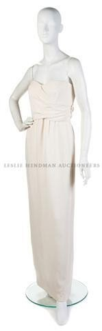 5: A Bill Blass Cream Strapless Evening Gown. Size 8.