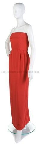 8: A Bill Blass Red Silk Satin Strapless Evening Gown.