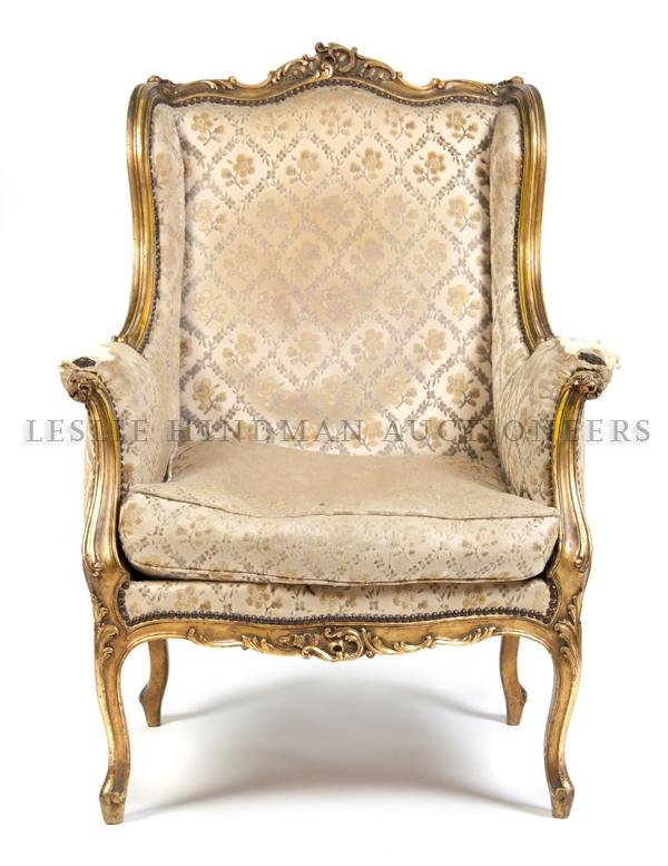 18: A Louis XV Style Giltwood Wingback Armchair, Height
