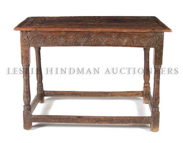 546: A Jacobean Revival Carved Oak Low Table, Height 25
