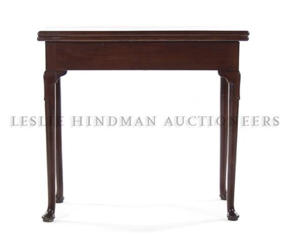 562: A George II Mahogany Flip-Top Table, Height 29 x w