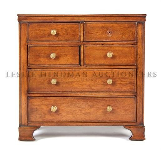 566: An English Miniature Mahogany Chest of Drawers, He
