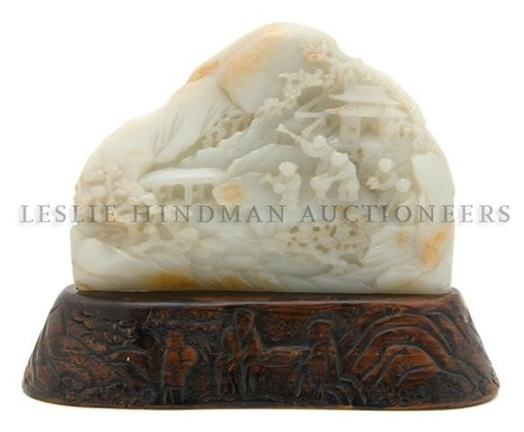 39: A Chinese Celadon Jade Boulder, Height 5 1/4 x widt