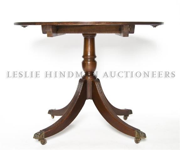 10: A Georgian Style Mahogany Extension Pedestal Table,