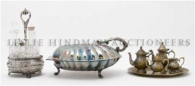 496: A Silverplate and Cut-Glass Cruet Set, Height of t