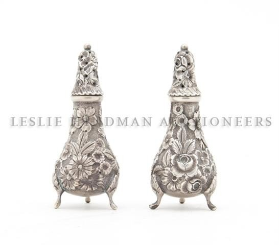 623: A Pair of Sterling Silver Casters, Height 3 7/8 in