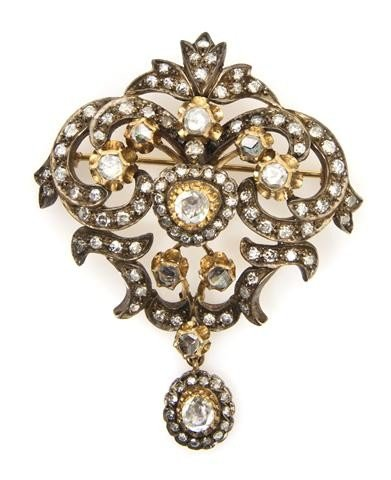 9: An Early Victorian Silver Topped Gold and Diamond Pe