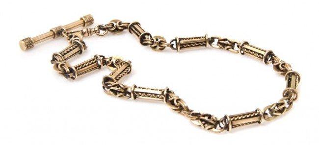 10: A Victorian 14 Karat Yellow Gold Fob Chain, 31.10 d