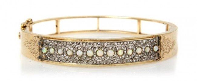 12: A 14 Karat Yellow Gold, Opal and Diamond Bangle Bra